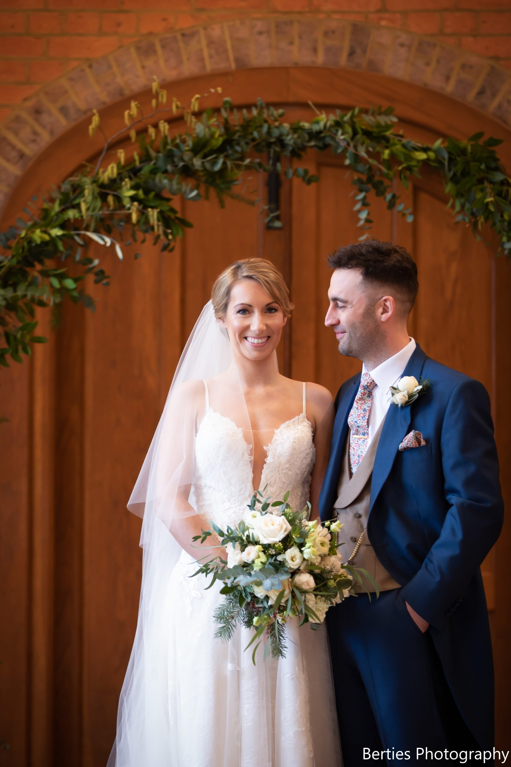 Wedding Bride and Groom in Royal Navy Morning Hire Suit and caramel double breasted waistcoat