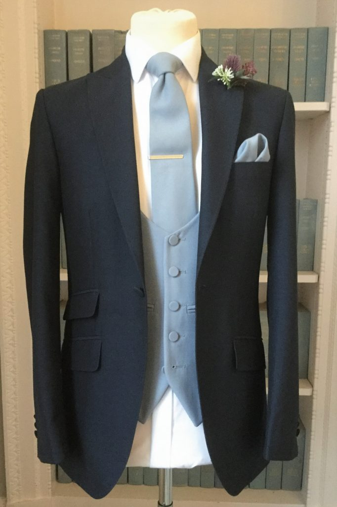 Navy Lounge Mens Wedding Hire Suit with grey waistcoat and tie by Black Tie Menswear