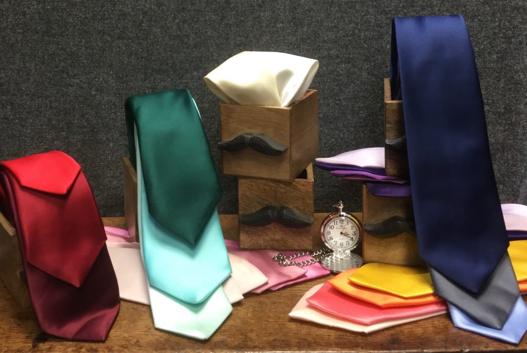 A selection of ties and neckwear including shades of navy, red, yellow and more