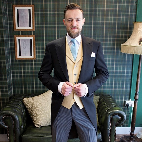 Royal Ascot Hire Formal Wear featuring Black morning tailcoat, grey striped trousers and yellow waistcoat by Black Tie Menswear